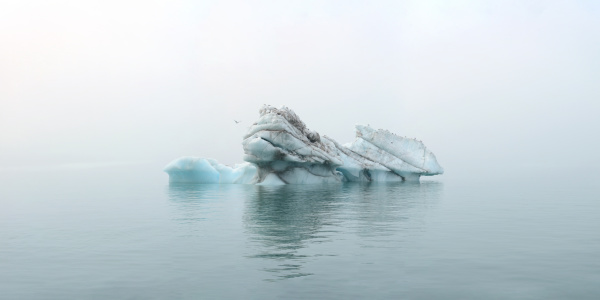 panorama image of iceberg carved by