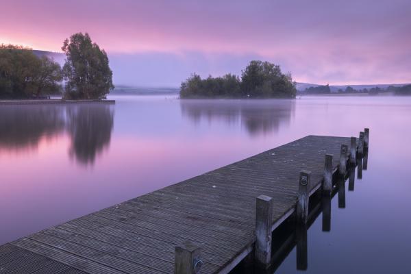 pink sunrise over llangorse lake in