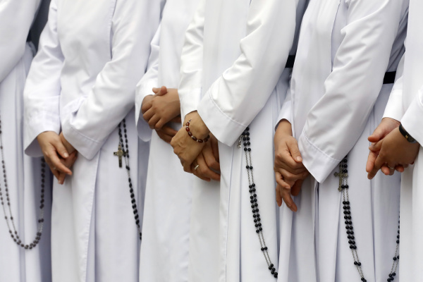 close up on hands and rosary