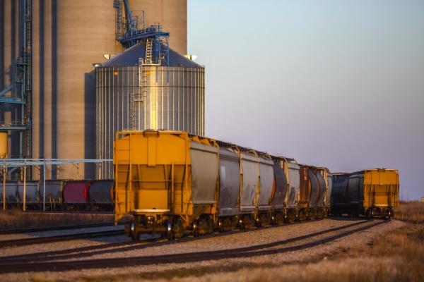 hopper wagon on a train beside