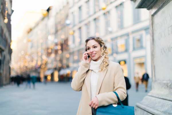 woman using smartphone at piazza firenze