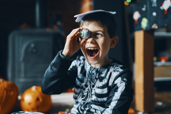 a boy dressed as a skeleton