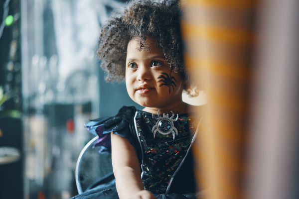 a child with dark curly hair
