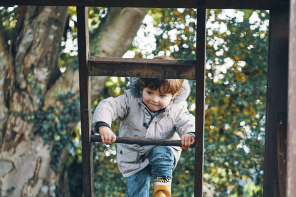 a child climbing a ladder with
