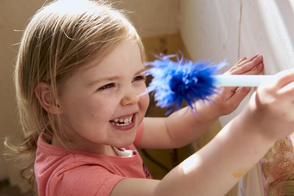 smiling girl indoors during corona virus