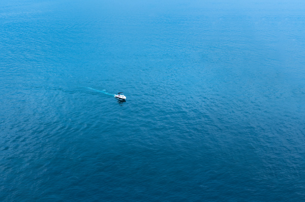 speedboat goes to sea in water