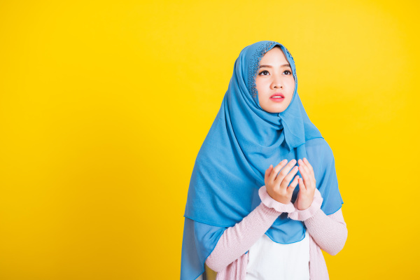 woman wearing hijab she henna decorated