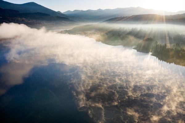 lovely autumnal landscape with fog over