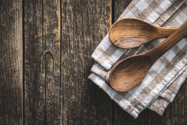 two wooden spoons on checkered napkin