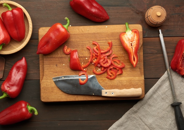 sliced red pepper on a wooden