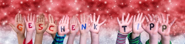 children hands geschenktip means gift tip