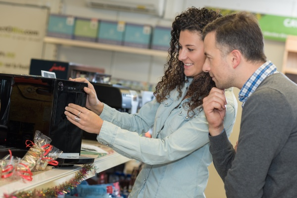 beautiful couple shopping for television