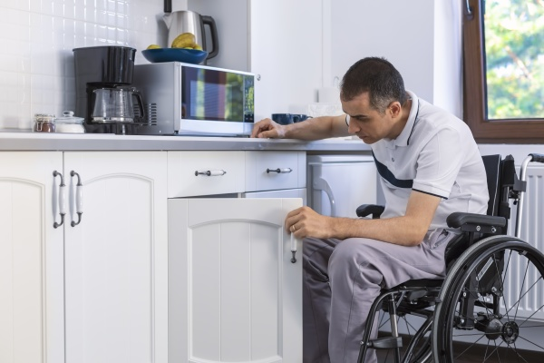 young man sitting on wheelchair in