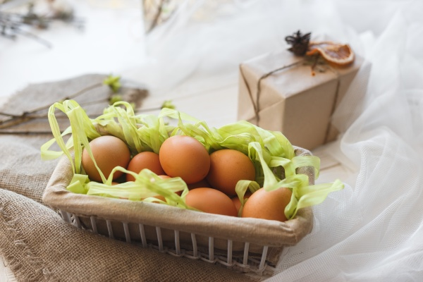 close up rustic basket with eggs