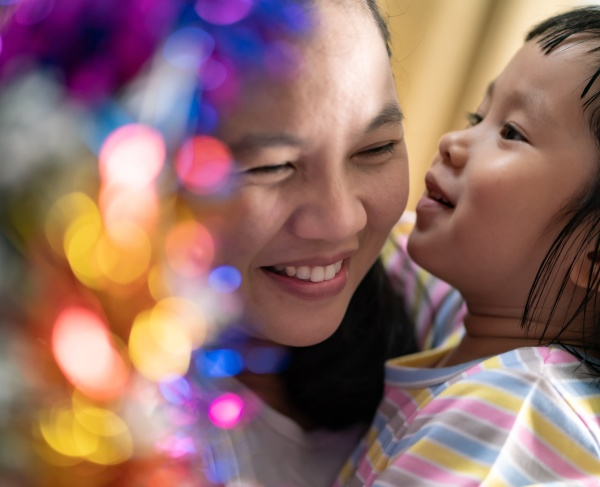 little asian girl with mom decorating