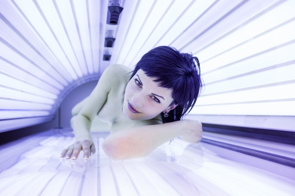 pretty young woman tanning her