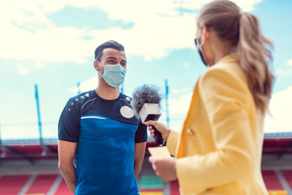 reporter doing interview with football player