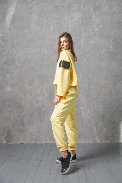 young woman in yellow sportswear