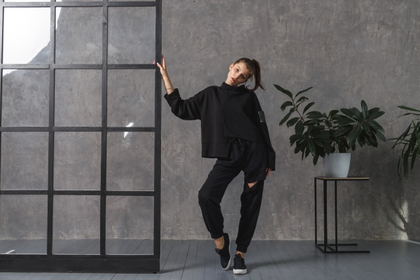 young woman in black sportswear