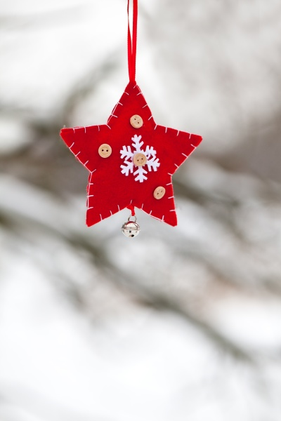 red white christmas star ornament in