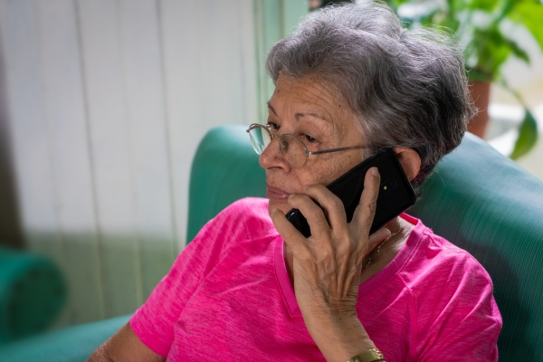 modern cell phone and old person