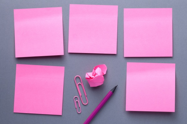 pink sticky note paper with office