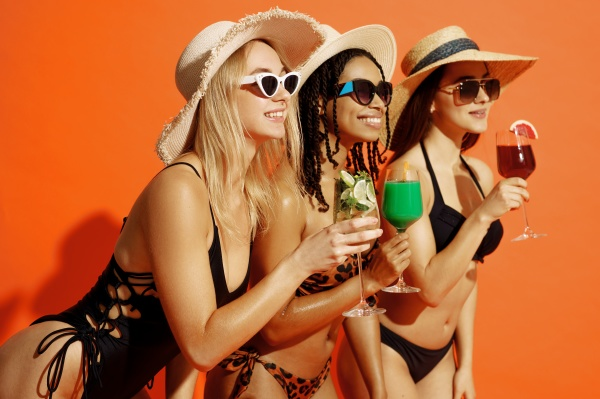 three sexy women in swimsuits holds