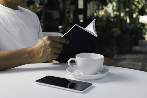 a man reading a book with