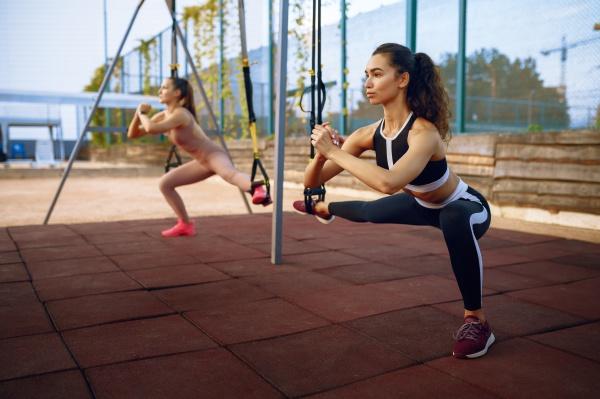 slim women doing balance exercise group