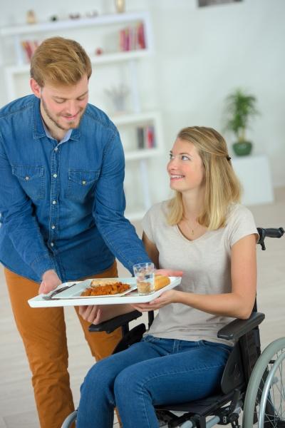 helpful boyfriend bringing her lunch