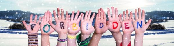 children hands building word forbidden snowy