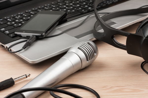 laptop microphone headsets lies on a