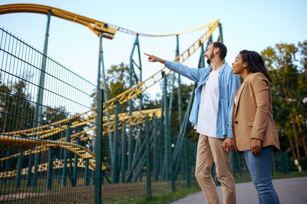 love couple at roller coaster in