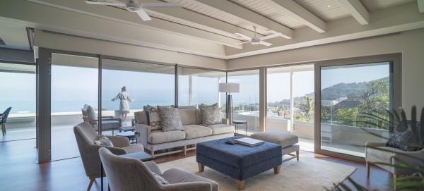 woman on luxury home showcase balcony