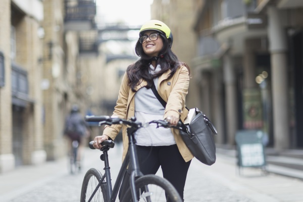 portrait smiling woman in helmet with