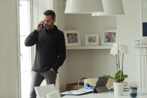 man working from home talking on