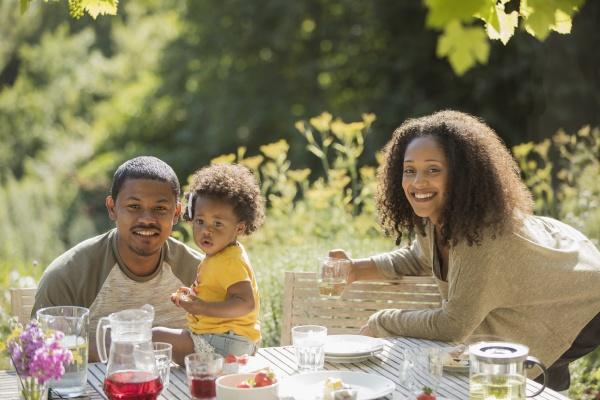 portrait happy family enjoying summer garden