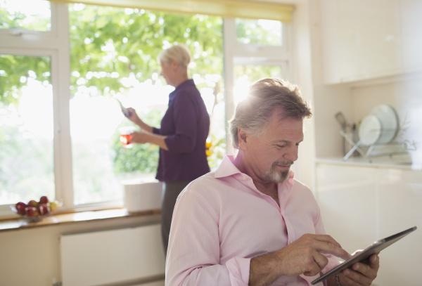 senior man using digital tablet in