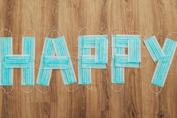 letters happy composed of blue medical
