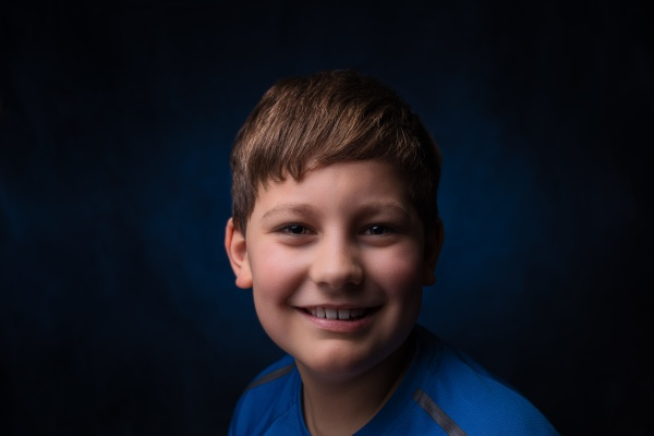 cheerful smiling european boy with