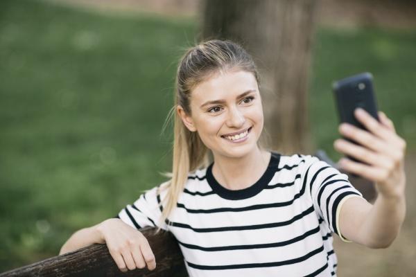 beautiful woman taking selfie on smart