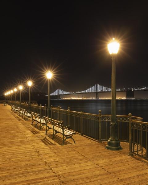 street light on pier with oakland