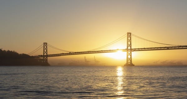 oakland bay bridge during sunset at