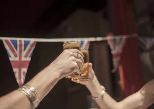female friends toasting beer glasses while