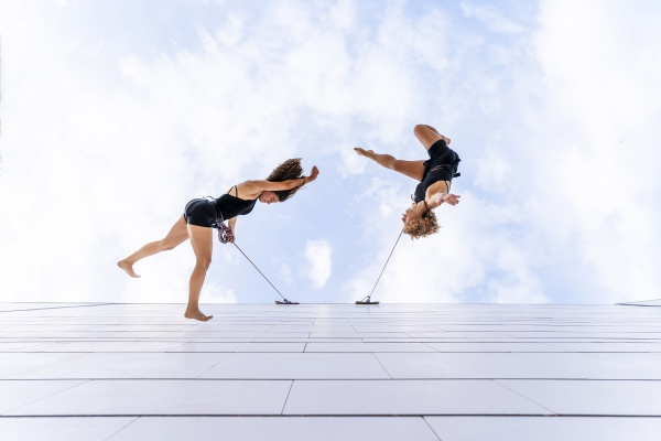 female dancers dancing against sky