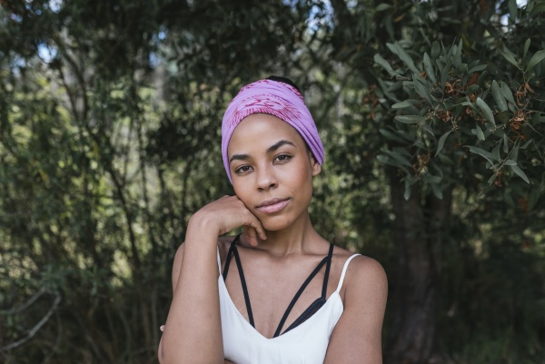 confident young woman with purple bandana