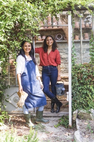 female friends standing in back yard