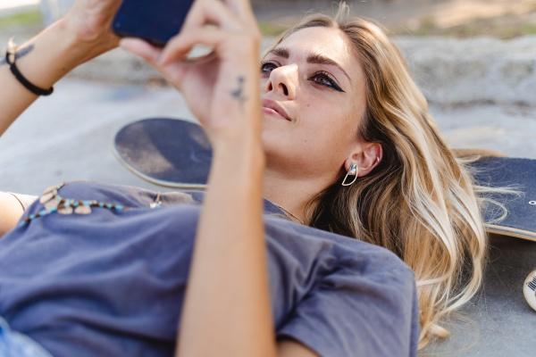 beautiful woman using smart phone while