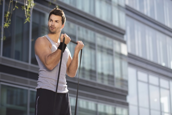 man training with fitness band