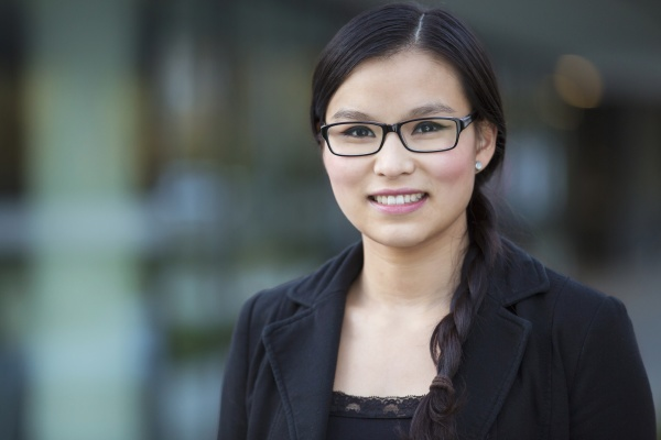portrait of smiling young businesswoman wearing